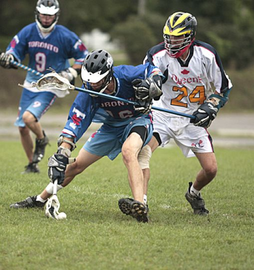 Gaels' defenseman Jonah Withers challenges Toronto's middle Mikael Chullen.