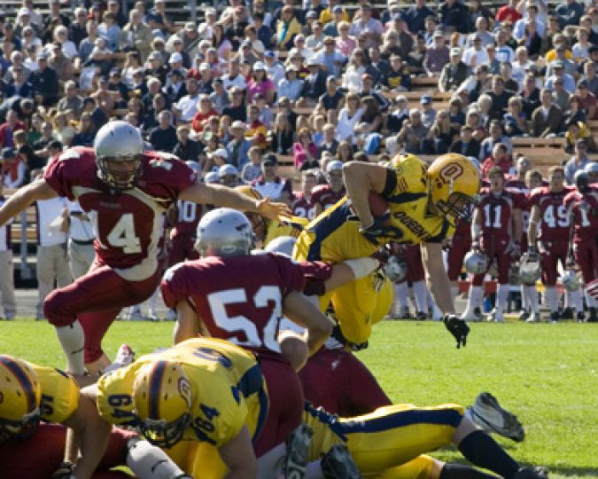 Gaels' running back Mike Giffin hurdles defenders.