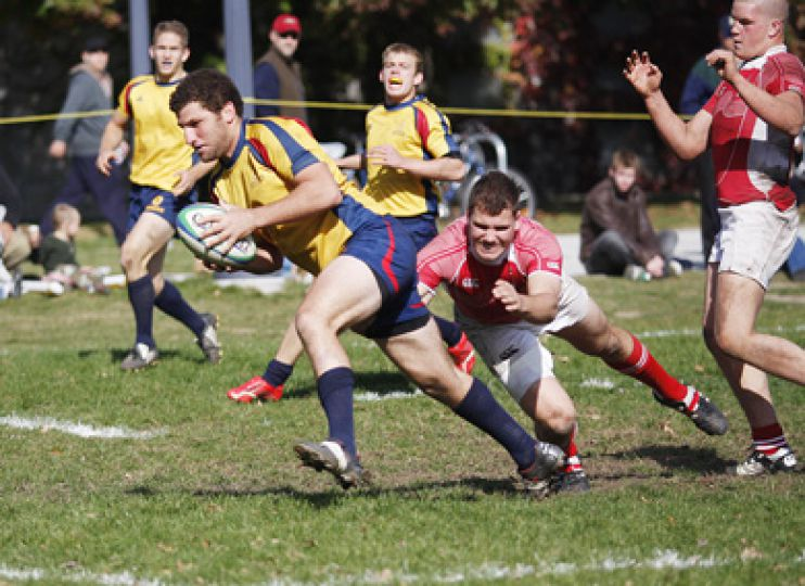 Queen's men's rugby number eight Xander Menetz-Sinchein makes a tackle Saturday against the Royal Military College Paladins. For full story, refer to the Sports section.