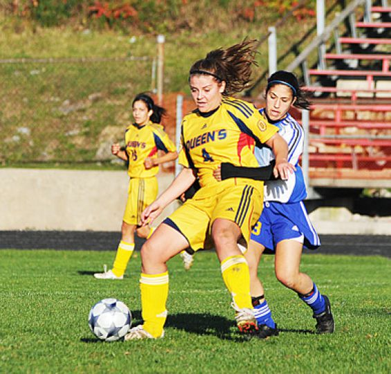 Ryerson's Andrea Raso battles Queen's Taylore Shaw for the ball in Saturday's game.