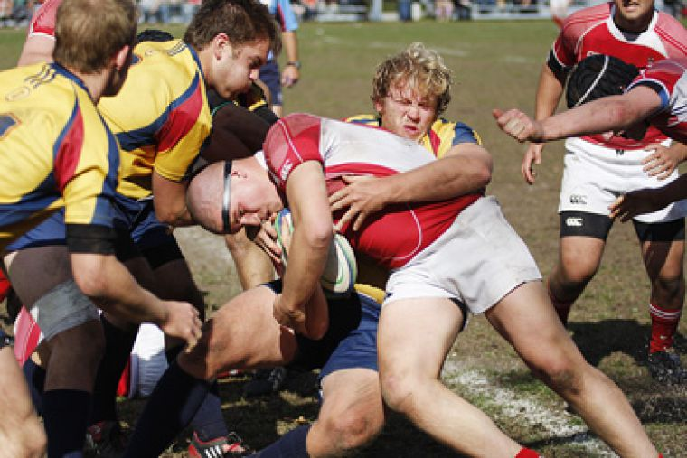 Gaels' prop Graham Watt hits RMC's Simon Gingues Saturday. Queen's won 92-20 to finish the season undefeated.