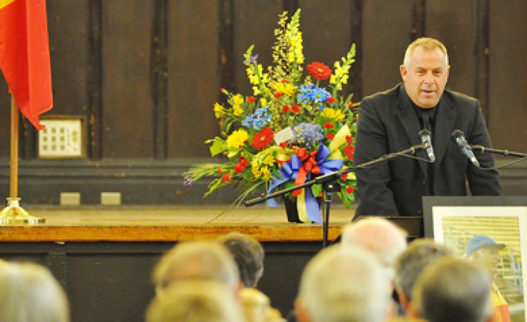 "Football head coach Pat Sheahan speaks at the memorial service for famed former player and coach Hal ""Moose"" McCarney at Grant Hall yesterday."