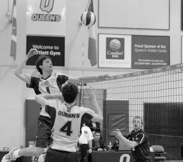 Gaels' middle hitter Will Bulmer goes for a spike against Western Sunday.