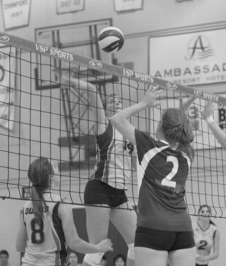 Gaels' middle Christiane Taylor goes up for a spike against Ottawa.