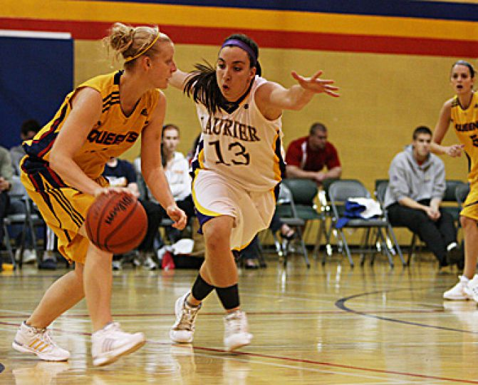 Queen's guard Lyndsay Gauley drives against Laurier's Amanda McDonald.