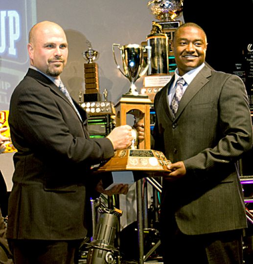 Gaels' middle linebacker Thaine Carter with the President's Trophy last Thursday.