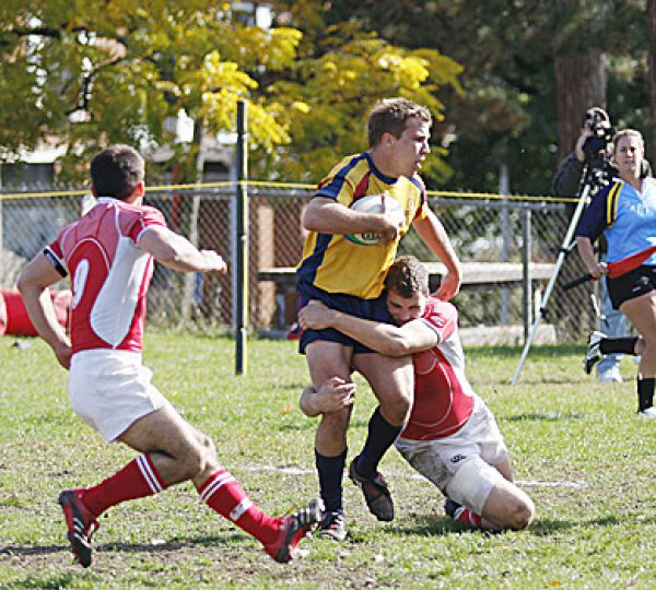 Alistair Clark tries to escape a tackle Oct. 18 against the RMC Paladins.