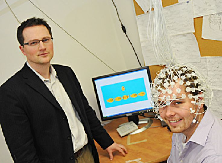Christopher Bowie (left) and Jeremy Stewart (right) test out an electroencephalogram. Bowie was awared $74,500 for his research project on neurocognitive impairment in individuals suffering from schizophrenia. For full story, see page 5.
