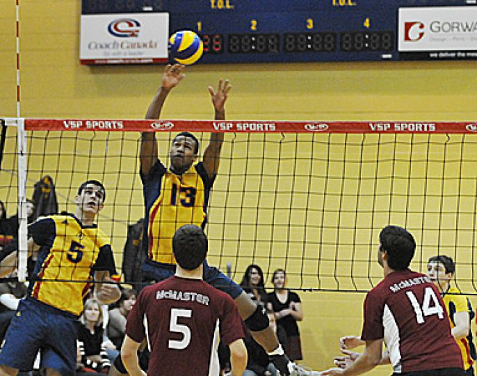Men's volleyball middle hitter Michael Amoroso goes up for a block Saturday against the McMaster Marauders as teammate Joren Zeeman (5) looks on. Queen's won in five sets. For full story, refer to the sports section.