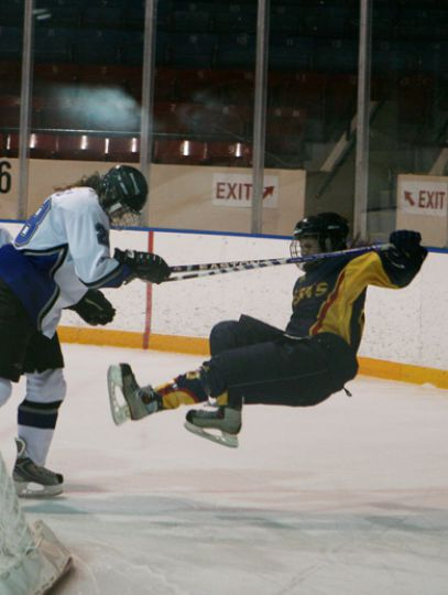 Queen's forward Liz Kench gets knocked down by UOIT defender Jordan Whately Saturday at the Memorial Centre. The Gaels lost 3-0 to the Ridgebacks.