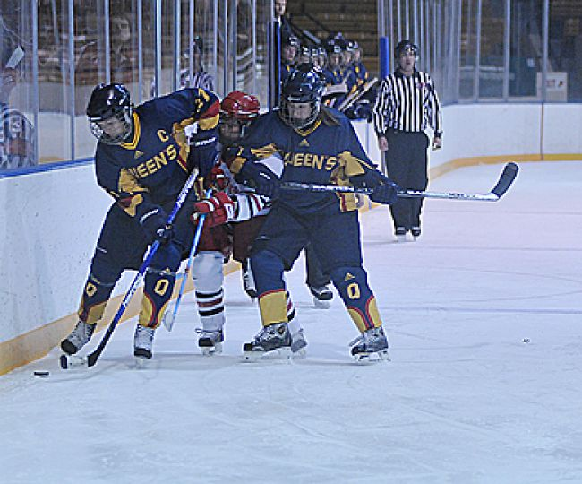 Gaels Cassie Sparks (37) and Victoria Kaufman (27) fight for the puck against York's Courtney Unruh Saturday.