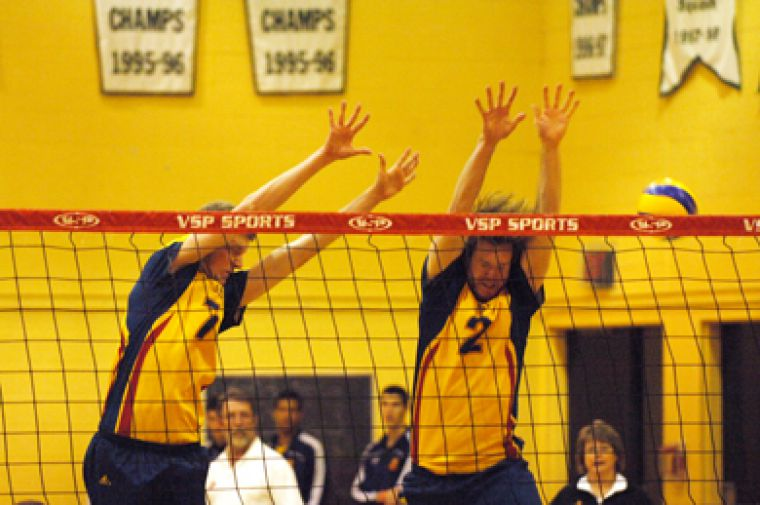 Gaels Darren Edwards (7) and Jeff DeMeza (2) try for a block against RMC Wednesday.