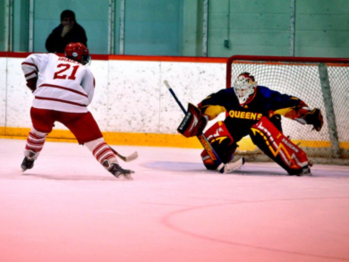 Male athlete of the week Brady Morrison prepares to make a shootout save against the Royal Military College's Paul Bradley last Friday at Constantine Arena. The Gaels won 4-3.