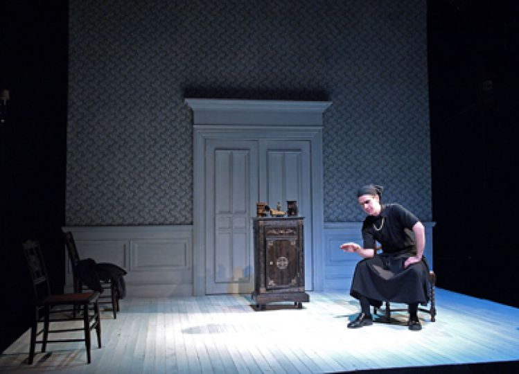Sleek lighting and set design maintain a professional tone for I Am My Own Wife.