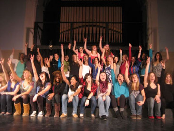 The cast of The Vagina Monologues leads the audience in a rousing chant of the word 'vagina.'