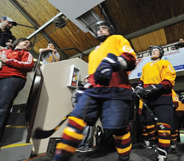 Queen's men's hockey players enter the Memorial Centre wearing throwback jerseys for the annual Carr-Harris Cup. For full story, please see Sports section.