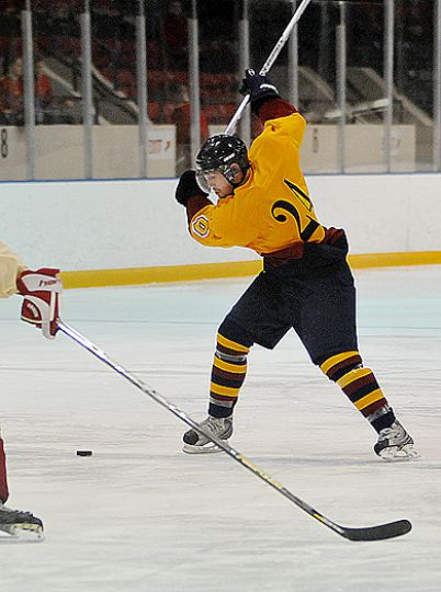 Queen's forward Jeffrey Johnstone winds up for a slap shot Saturday at the Memorial Centre.