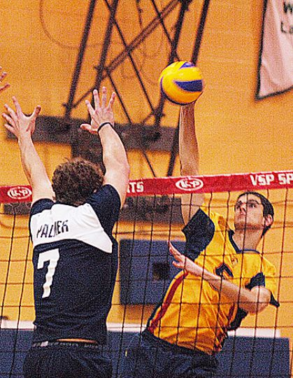 Gaels' outside hitter Joren Zeeman (5) goes for a kill Friday night against Ryerson Rams' outside hitter Luka Milosevic.