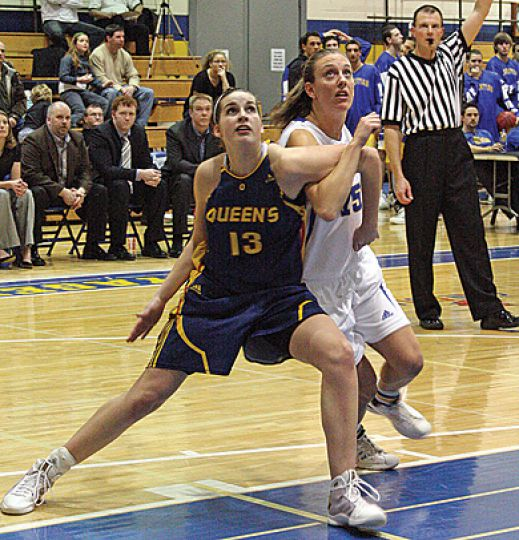 Queen's Erin Skippon tries to box out Laurentian's Darrah Bumstead for a rebound Friday. The Gaels lost 71-55.