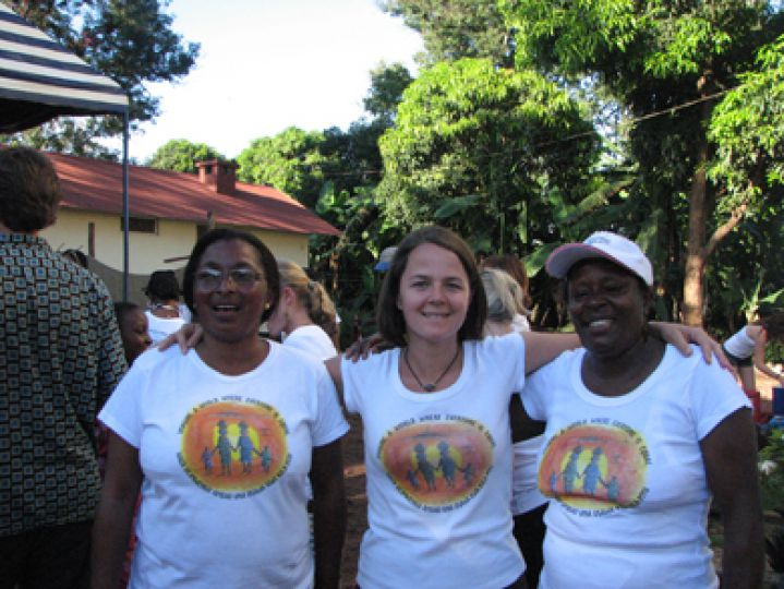 Dr. Karen Yeates (center) stands with Agnes Mtambo, the local administrator of the Pamoja Tunaweza Women's Centre (left), and Sekunda, both of whom are HIV-positive.