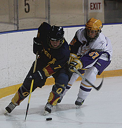 Laurier's Alison Williams tries to check Queen's Megan McNutt. Queen's lost 7-0.