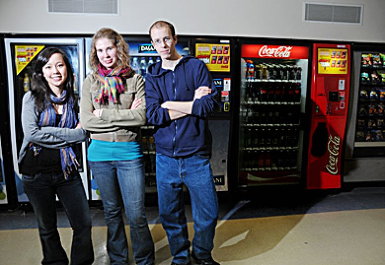 Anti-Coca-Cola organizers Andrea Jones, ArtSci '11, Claire McDougall, ArtSci '09 and James Douglas, ArtSci '08, put forward a motion at Tuesday's AMS Annual General Meeting for the University to end its exclusivity contract with Coca-Cola.