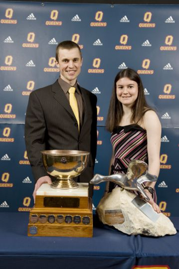 Jack Jarvis Trophy recipient Nick Pratt of the rowing team and Marion Ross Trophy recipient Leslie Sexton of the cross-country team and the track and field team pose, awards in hand. Pratt earned an gold medal in the men's lightweight eight and a silver medal in the men's lightweight four at the OUA championships and went on to pick up two silver medals at the Canadian University Rowing Championships. Sexton represented Canada in cross-country at the FISU Games in August and earned a silver