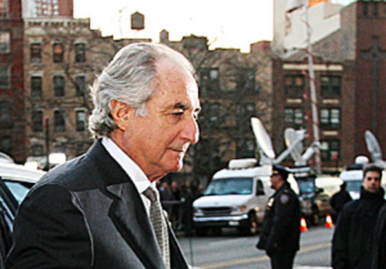 Former businessman Bernie Madoff, seen here leaving court, defrauded thousands of investors for approximately $65 billion. Madoff, who faces up to 150 years in prison, will be sentenced on June 29.