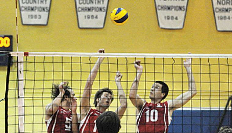 The Canadian national men's volleyball team, ranked 22nd in the world, won a five-set match against 14th-ranked Australia in Bartlett Gym last week. Canada's Brock Davidiuk (5), Adam Kaminkski (14) and Toon Van Lankvelt (10) go up for a block.
