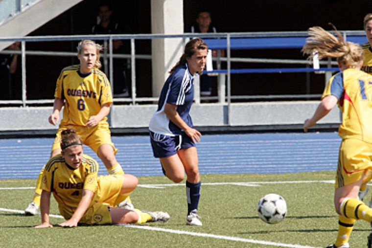 Gaels midfielders Angela Sullivan (4), Mary Kampman (6) and Erin Smith try to get the ball off a University of Toronto player during Sunday afternoon's loss against the Varsity Blues.
