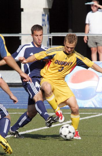 Gaels' first-year defender Matt Kenny plays keep-away from a University of Toronto striker.