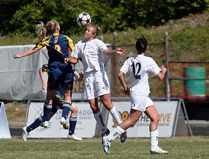 Gaels forward Kelli Chamberlain rises for a header against Nipissing defender Justine Carlyle during Sunday's 3-1 home victory.