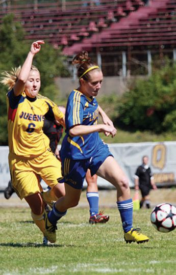 Queen's midfielder Cristina Senese dogs Laurentian defender Stephanie Mackay for possetion during Saturday's 3-0 win at Richardson.