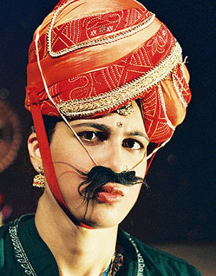 Anita Majumdar performs as many different characters in her one woman show Fish Eyes.