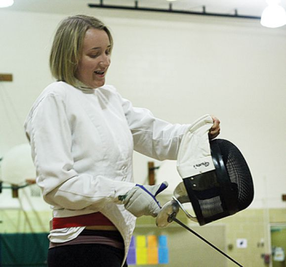 Journal reporter Emily Davies attempts to duel with men's foil team captain and assistant coach Christian Petrozza.