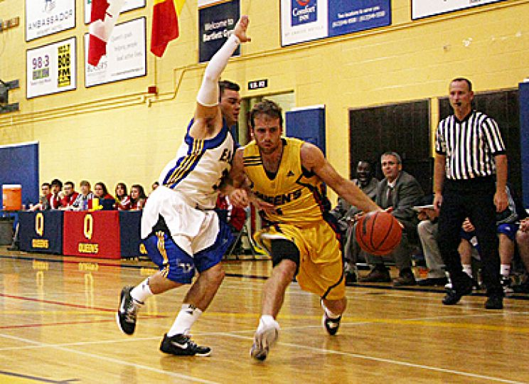 Gaels point guard Baris Ondul drives for the basket in Saturday's demolition of King's College.