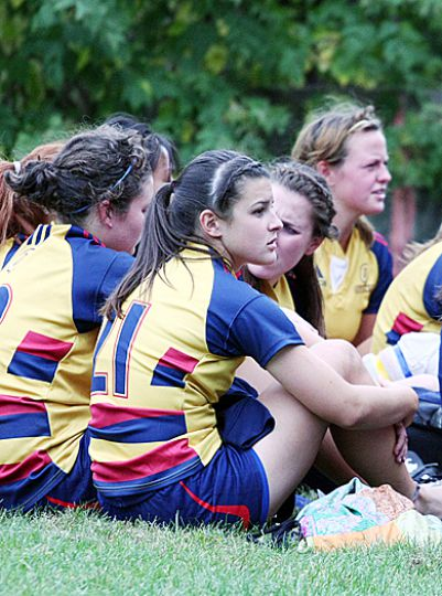 The women's rugby team sit dejected after their 39-6 loss at the hands of the McMaster Marauders on Saturday afternoon.