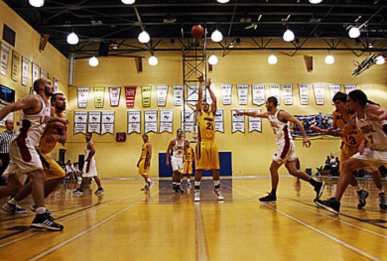Forward Kurtis Lawes takes a foul shot against Laval on Saturday night at Bartlett Gym.