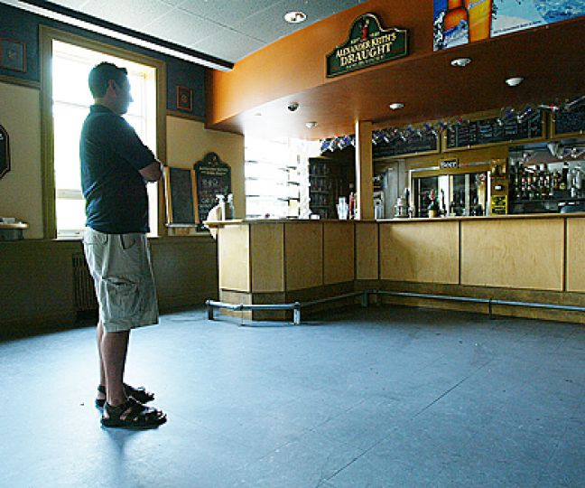 Charlie Scott, EngSoc president 2007-08, stands in an empty Clark Hall after the bar abrubtly closed down due to years of financial mismanagement.