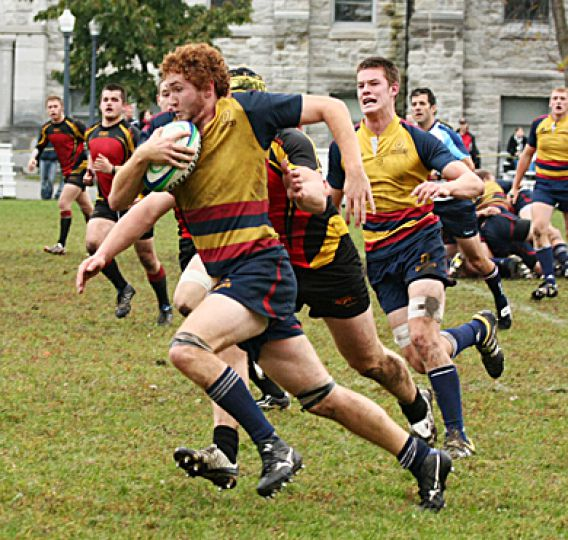 Gaels second-row James Rees runs past Guelph's defence during Friday's 31-5 win at Kingston Field.