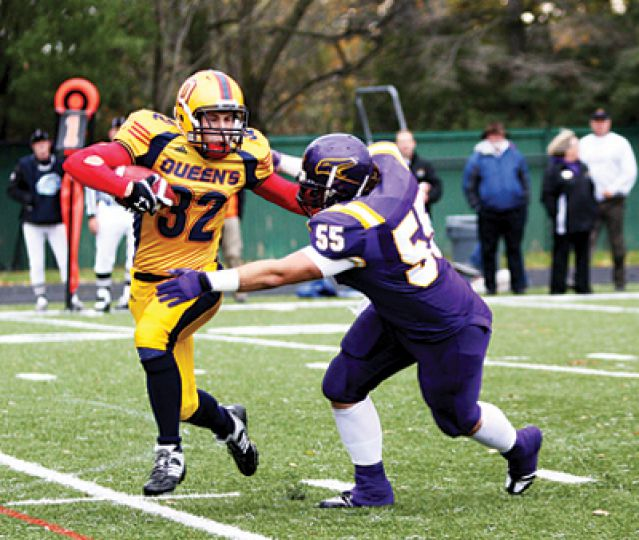 Running back Ryan Granberg evades a tackle from Laurier defensive lineman Paul Hancock during Saturday's 25-13 loss.