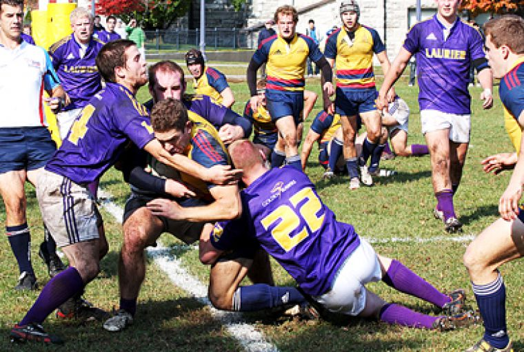 Gaels' winger Zach Pancer breaks through three Golden Hawks defenders to score the 12th Tricolour try of Saturday's 74-8 romp over Wilfred Laurier.