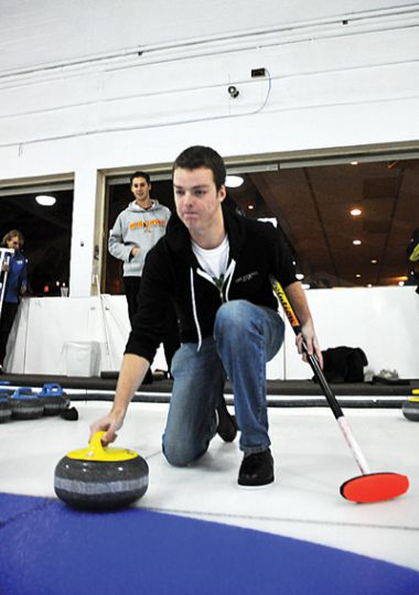 Journal Editor in Chief Michael Woods tries his hand at curling.