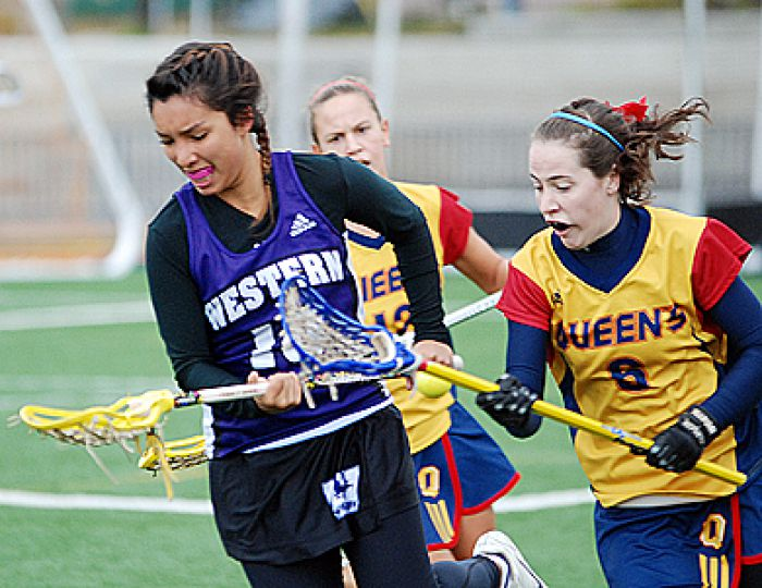 Martha Ross tries to get the ball off Western's Hilary Miles last Saturday during the Gaels' 8-7 loss.