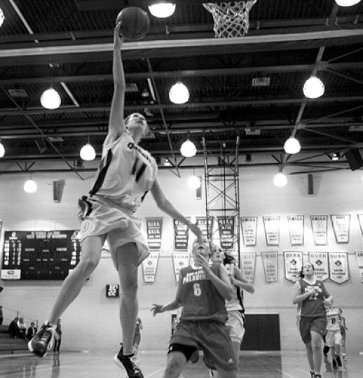 Wing Christine Wallace rises for a layup during Queen's 73-27 demolition of the Royal Military College Paladins on Friday night at Bartlett Gym.
