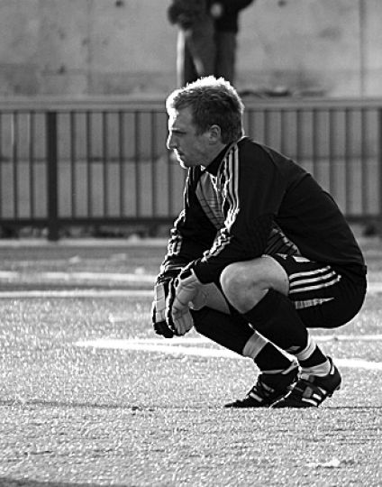 Goalkeeper Sean Martin-Courtight sits dejected after the last Carleton penalty went in at Tindall Field.