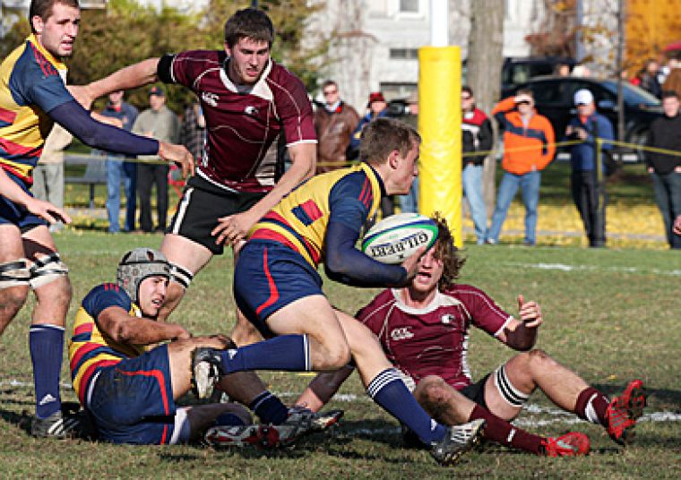 Gaels scrum-half Andrew Kirk tries to find a path through McMaster's defense.