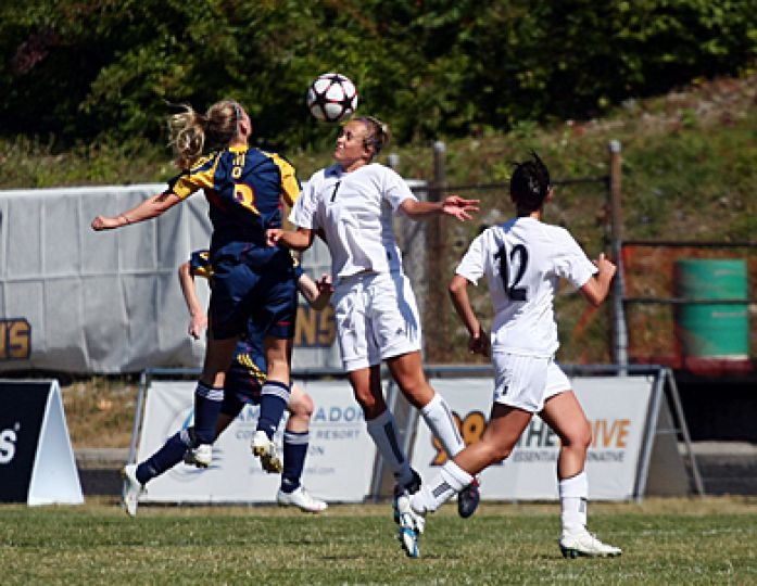 Striker Kelli Chamberlain (left) goes up for a header during the Gaels' 3-1 win over Nipissing on Sept. 20. Chamberlain scored two goals against Laurier during Friday's 3-2 semifinal win.