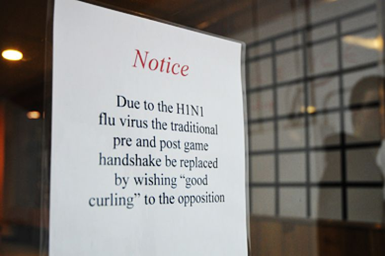 H1N1 concerns have impacted all sports, including curling. Post-game handshaking is forbidden at the Cataraqui Golf and Country Club.