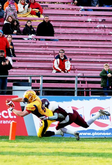 Running back Marty Gordon dives for a touchdown during the Gaels' 32-6 win over the McMaster Marauders last Saturday.